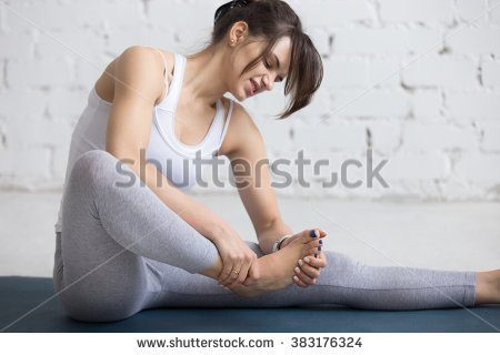 stock-photo-beautiful-young-woman-feeling-pain-in-her-foot-during-sport-workout-indoors-close-up-focus-on-383176324
